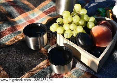 Autumn Picnic Tea Thermos With Grapes And Peaches. Fruits And Tea On Blanket. Outdoor Lunch. Picnic