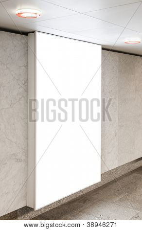 Blank billboard located in underground hall useful for your advertising