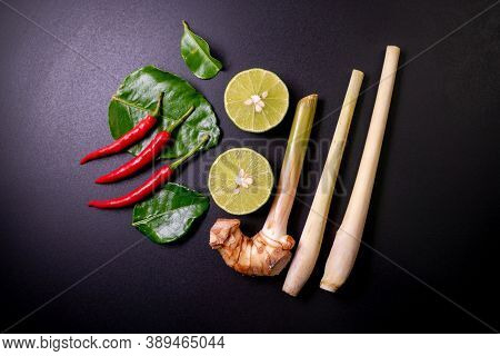 Mix Ingredients Of Tom Yum Goong On Black Table, Composed Of Lime, Red Chili, Kaffir Lime Leaf, Lemo