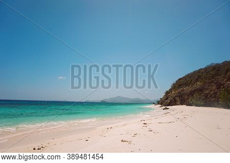 Clear Skies And White Sand On A Tropical Beach