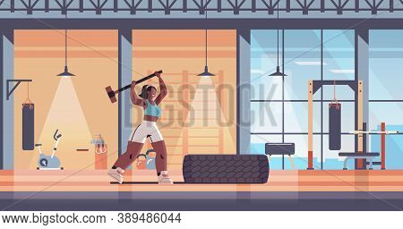 Sportswoman Hitting Tire With Hummer Girl Doing Hard Exercises Working Out Fitness Training Healthy