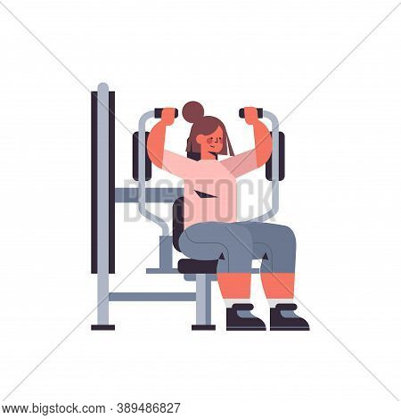 Sportswoman Exercising On Training Apparat Girl Doing Physical Exercises Working Out In Gym Healthy