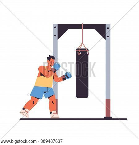Sportsman Doing Physical Exercises Male Boxer Hitting Punching Bag Working Out In Gym Boxing Studio