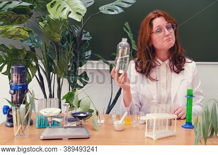 The Ecologist Examines The Water Samples Taken At A Desk In The Laboratory. Conducting Environmental