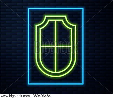 Glowing Neon Line Shield Icon Isolated On Brick Wall Background. Guard Sign. Security, Safety, Prote