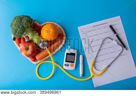 World Diabetes Day. National American Diabetic Awareness. Free Glucose Monitors On Blue Background.