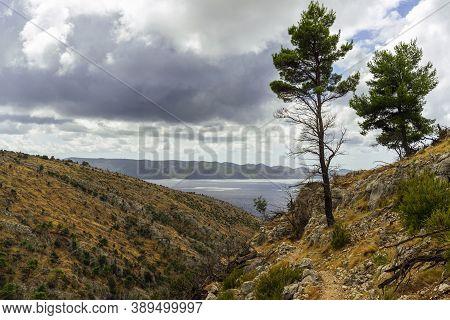Scenic Landscape With Sea Bay, Cloudy Sky And Mountain Slopes. Brac Island, Croatia.
