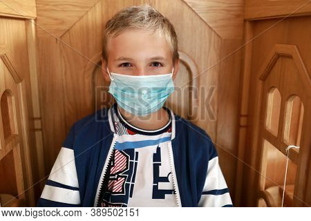 Portrait Of Child In Protective Medical Mask At Church