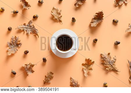 Pattern Of Black Coffee And Autumn Acorn Around On Beige Table. View From Above. Concept Substitute