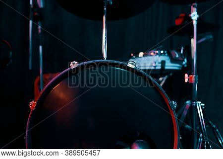 Drums Over Neon Light Background. Drum Kit On Stage For Concerts And Performances. Musical Percussio