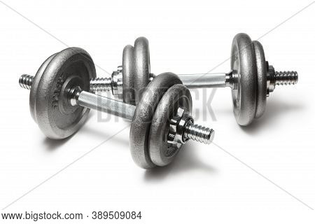 Metal Dumbbells For Fitness With Chrome Silver Handle Isolated On White