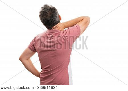 Adult Male Model In Summer Attire Having Muscle Pain Strained Touching Neck With Back To Camera Copy