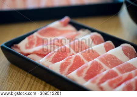 Thin Of Fresh Streaky Pork In Black Tray For Hot Pot Ready To Cook