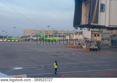 Moscow, Russia - October 11 2020: Domodedovo Airport. Jetway Doors On And Airport Runway With Flight
