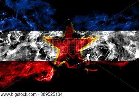 Yugoslavia, Yugoslavian Smoke Flag Isolated On Black Background