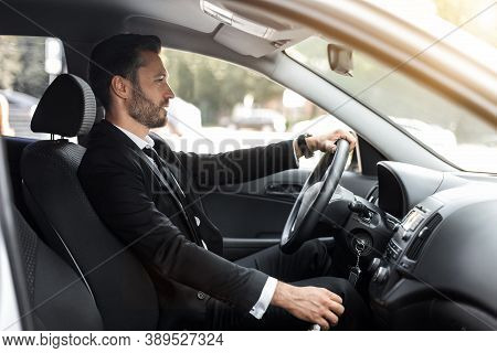 Handsome Businessman Driving Car To Airport, Going On Business Side View, Copy Space. Happy Man In S