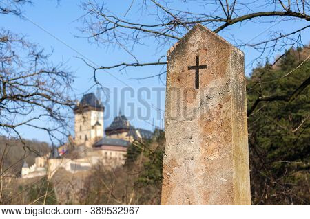 Religious Cross On Old Tombstone On A Sunny Day With Medieval Castle In Background, Death And Life E