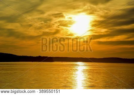 Awesome Sunset With Dramatic Clouds In The Sky Over Sea. Landscape Of Lake In Sunrise. Sunset Sea Ho
