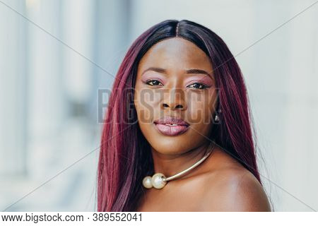 Elegant Beautiful African American Woman In Blue Dress With Pink Hair Hairstyle Smiling And Walking