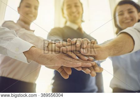 Close-up Of Smiling Business People Hands Pyramid Expressing Successful Project Realization Or Devel