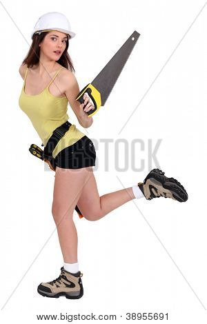 Attractive female builder with hand saw