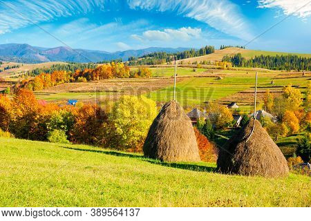 Rural Landscape In Mountains. Haystack On The Hill. Village In The Valley. Scenery In Fall Colors. B