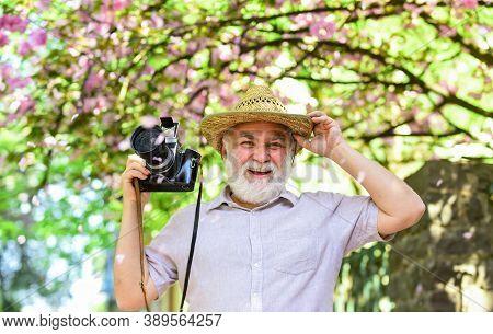 Spring Time. Senior Bearded Man Photographing Pink Blossom. Professional Photographer Designer. Happ