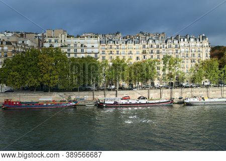 Paris, France. October 04. 2020. Residential Boats. Barge On The River Seine. Haussmannian Building