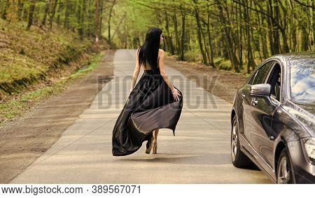 Hiking Solo. Travel Girl. Sexy Girl Walk Along Road. Fashion Look Of Sensual Girl. Pretty Girl Trave