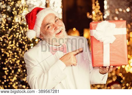 Best Present. Expensive Xmas Present And Business Reward. Senior Man Santa Hat Hold Gift Box. Bearde
