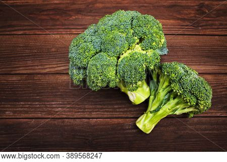 Fresh Green Broccoli On Wooden Background. Fresh Broccoli On A Wooden Table.
