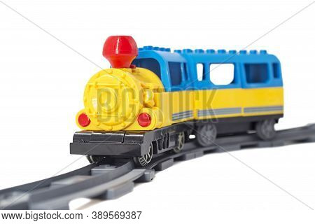 Colorful Toy Train On The Rails, Isolated On White Background. Train Toy For Young Children Isolated