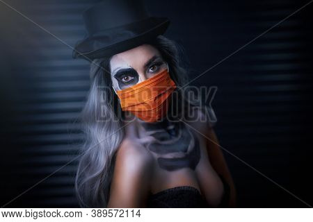 Spooky portrait of woman in halloween gotic makeup wearing protective mask