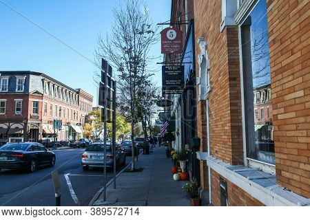 WOODSTOCK, VT, USA - OCTOBER 9, 2020: Central Street with morning autumn lights sidewalk view
