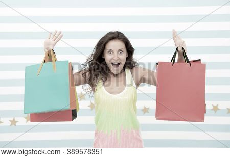 Feel Free Buy Everything You Want. Woman Carries Bunch Shopping Bags Striped Background. Finally Bou