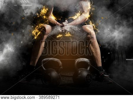 Weightlifter clapping hands and preparing for workout at a gym. Focus on dust. Lightning effect