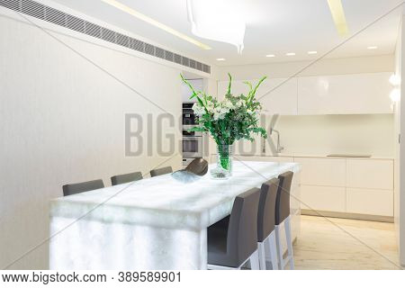 Luxury Dining Room With Glow Table In Modern Home
