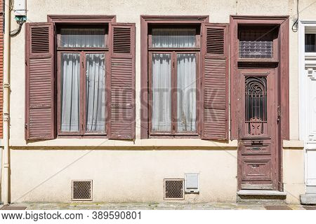 Lille, France - July 19, 2013. Outside An Old French House With Wooden Doors And Windows With Shutte