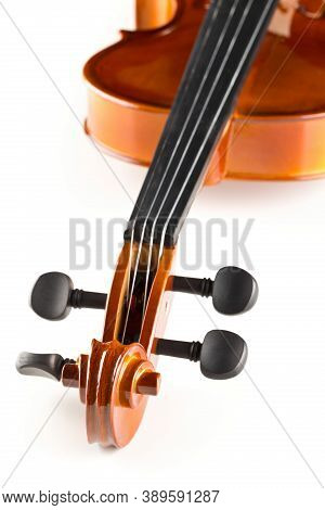 Close Up Macro Of Scroll On Brown Wooden Fiddle Or Violin, Classic Musical Instrument, Over White Ba