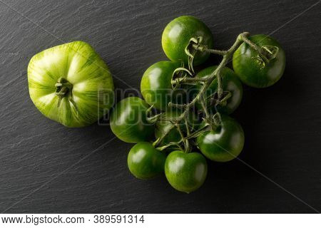Unripe Green Tomatoes On Dark Stone Plate Background, Unripe Tomatoes Can Be Fried Or Used For Relis