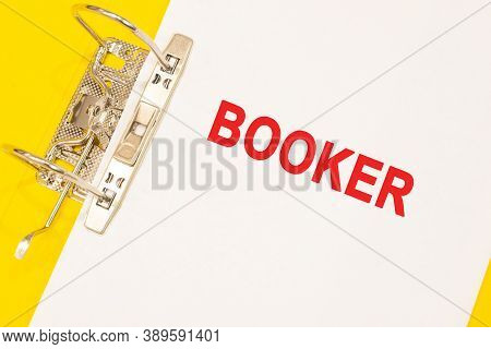 The Word Booker On A White Background With A Yellow Folder. Business Concept