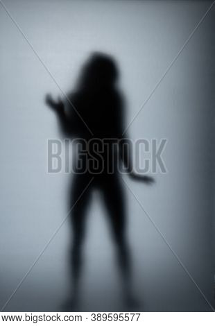 Horror Woman Silhouette In Window. Horror Scene. Halloween Concept. Blurred Silhouette Of Ghost. Gho