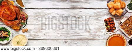 Traditional Thanksgiving Turkey Dinner. Overhead View Double Border On A Rustic White Wood Banner Ba