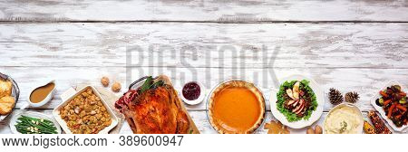 Classic Thanksgiving Turkey Dinner. Above View Bottom Border On A Rustic White Wood Banner Backgroun