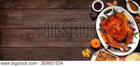 Traditional Thanksgiving Turkey Dinner. Overhead View Side Border On A Dark Wood Banner Background W