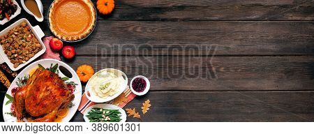 Traditional Thanksgiving Turkey Dinner. Top Down View Corner Border On A Dark Wood Banner Background
