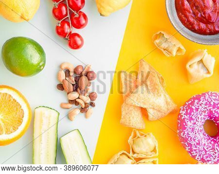 Healthy And Unhealthy Food, Dieting Concept. Fast Food On Yellow And Green Vegetables, Nuts And Frui
