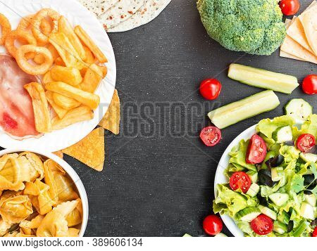 Healthy Vs Unhealthy Food And Dieting Concept. Junk Food And Green Salad Vegetables In Bowls Isolate