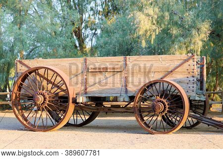 October 5, 2020 In Furnace Creek, Ca:  Historical Wooden Wagon Used For Mining On Display At The Bor