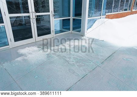 Melting Salt And Ice In Front Of Entrance Gate Office Building